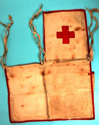 apron with red trim and Red Cross emblem sewn on front