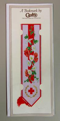 bookmark with tassle, decorated with flowers and the emblem