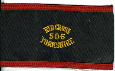 Navy brassard with red edging, 'Red Cross 506 Yorkshire'