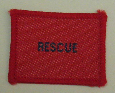 Plain red cloth badge for Youth uniform 'Rescue'.