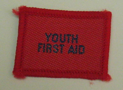 Plain red cloth badge for Youth uniform 'Youth First Aid'.