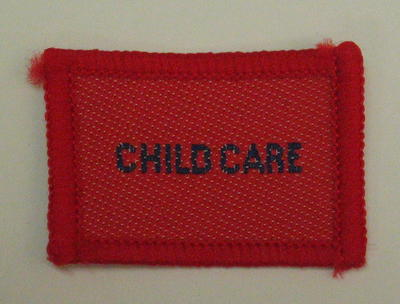 Plain red cloth badge for Youth uniform 'Child Care'.