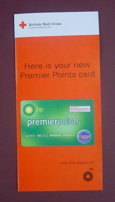 green plastic Argos premier points reward card with BP sponsorship logo mounted on associated leaflet