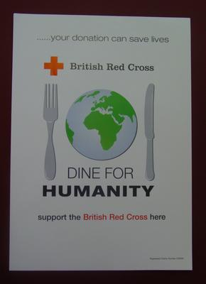 white poster featuring a knife and fork surrounding a globe with the words, 'Dine for Humanity'
