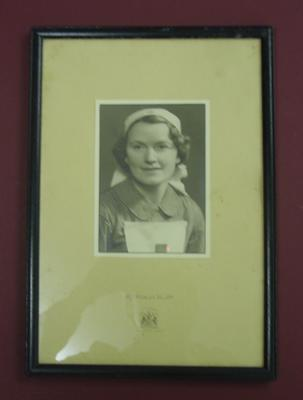 Photographic portrait of Mrs Evelyn Gertrude Ford in British Red Cross VAD uniform