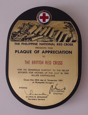Wood and brass plaque fromThe Philippine National Red Cross to The British Red Cross for its support following an earthquake in 1990