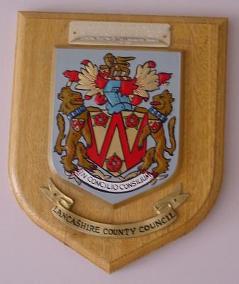 Brass and wooden shield featuring the badge of Lancashire County Council presented to Countess Limerick on the 11th July 1991