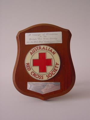 Small wooden shield presented in friendship to the British Red Cross by the Australian Red Cross Society, Tasmanian Division