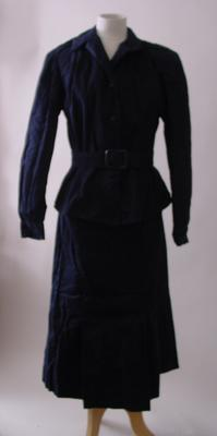 suit consisting of navy jacket, skirt and belt worn by Lady Eastwood