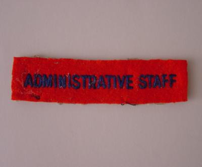 Administrative Staff cloth badge: blue embroidery on red felt background