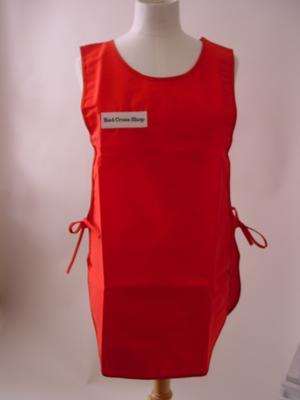 Red tabard, with 'Red Cross shop' embroidered black on white on front right.