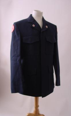 Mens navy jacket, trousers and white shirt with insignia