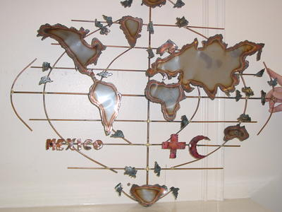 Metal 'sculpture' map of the world with Red Cross and Red Crescent symbols
