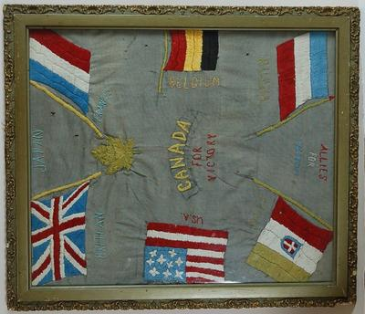 Embroidery showing the flags of Britain, France, Belgium, Russia, Italy and the USA around the words 'Canada for Victory'