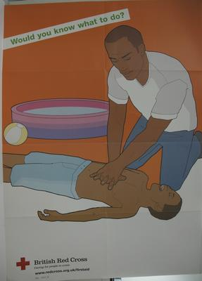 Large poster showing a man administering external chest compressions on a young boy. The boy lies next to a paddling pool. With the words: 'Would you know what to do?'.