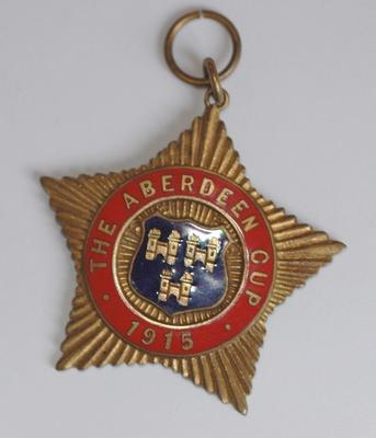 pendant: 'the Aberdeen Cup 1915'