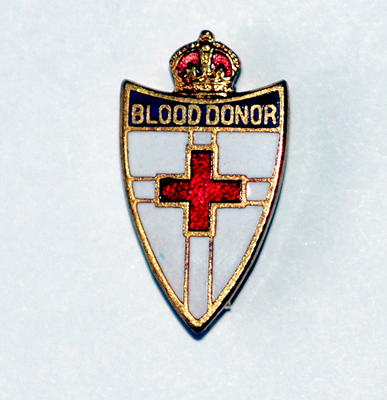Small shield-shaped badge with gilt crown on top: Blood Donor.