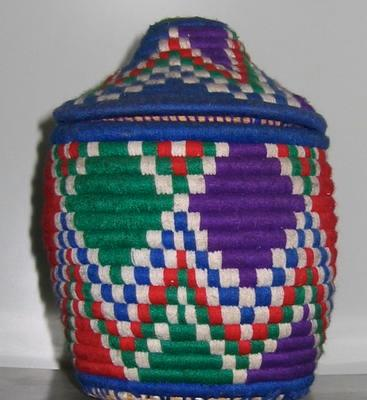 container with lid made of woven thread