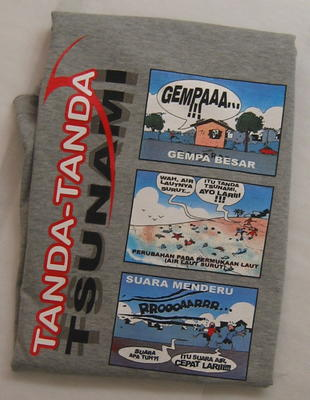 long sleeved t-shirt with coloured cartoon images of the tsunami