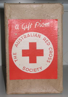 Empty cardboard box with label: 'A Gift from The Australian Red Cross Society'