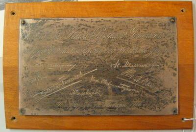Wood mounted metal plaque, engraved with signatures, dated 1916