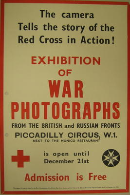 Small poster: 'The camera Tells the story of the Red Cross in Action! Exhibition of War Photographs From The British and Russian Fronts. Piccadilly Circus, W.1. Next to the Monico Restaurant is open until December 21st. Admission is free.'
