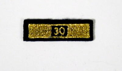 Service award consisting of a gold stripe with '30' incorporated in the design: 30 Years Service.