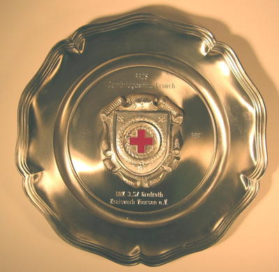 Souvenir metal plate: 'British Red Cross Cambridgeshire Branch April 1987. DRK 3.SZ Grefrath Kreisverb Viersen e.V.'