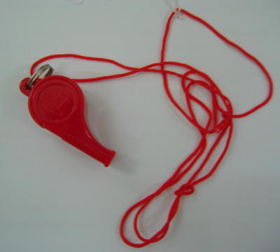 Red plastic whistle