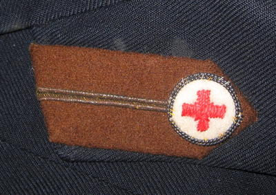 uniform jacket with brown gorget patches and embroidered pip