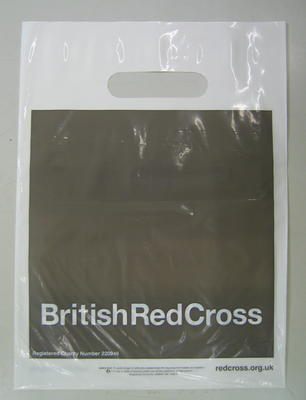 Small grey plastic bag with the words British Red Cross in white, reflecting the new style of branding introduced in 2006.