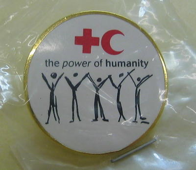 circular badge: 'the power of humanity'