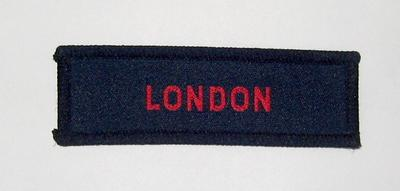 Cloth flash, red on navy blue: London