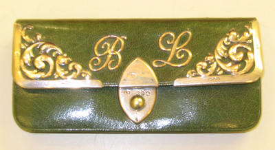 purse with the initials B.L.
