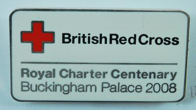 Small rectangular metal badge: British Red Cross. Royal Charter Centenary Buckingham Palace 2008.