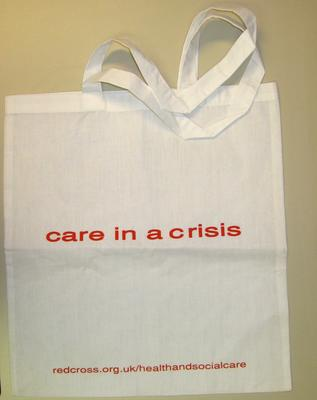 cloth bag: care in a crisis with the url for health and social care