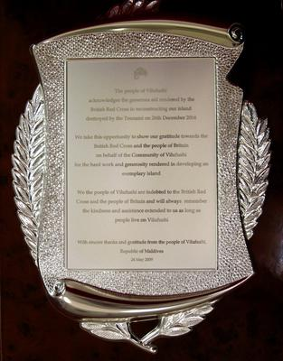 Decorative silver plaque in a red velvet presentation case which was a gift to the British Red Cross from Vilufushi, Maldives