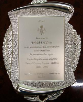 Decorative silver plaque in a brown case presented to the British Red Cross by the National Disaster Management Centre Maldives