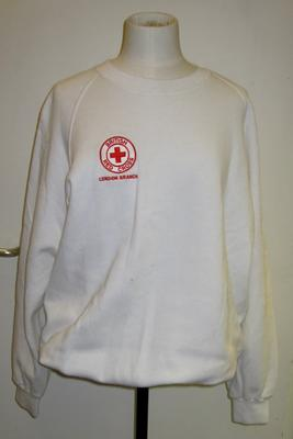 white sweatshirt with embroidered insignia