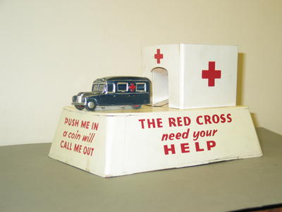 collecting box with small model ambulance which moves when a coin is inserted