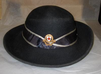 Ladies felt hat with ribbon and badge