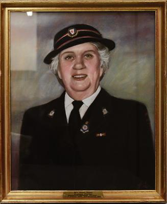 Framed pastel portrait of Mrs Vernon-Walker in British Red Cross outdoor uniform.