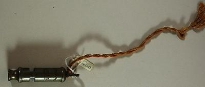 Metal Police whistle on a piece of string: 'The Metropolitan'. J. Hudson & Co. Barr St. Hockley Birmingham.