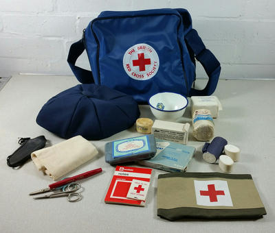 Navy blue washproof plastic first aid bag with contents