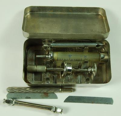 Syringes in a chrome-plated tin