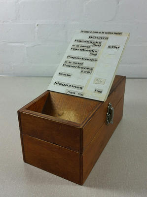 Collecting box for a Hospital Library trolley