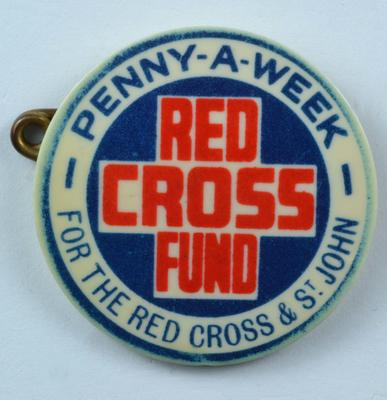 'Penny-a-Week/Red Cross Fund/For the Red Cross & St John' badge, plastic, circular.