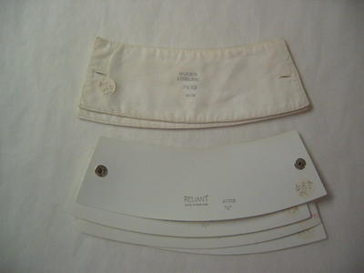 "Set of plastic cuffs stamped 'Reliant. Made in England. Agnes 7 1.2"" '"