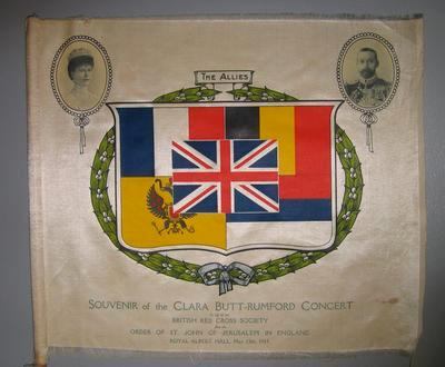 Large silk flag on stick: 'Souvenir of the Clara Butt - Rumford Concert, Royal Albert Hall, 13 May 1915 in aid of British Red Cross Society & Order of St John'.