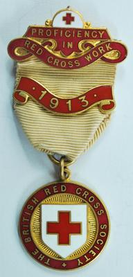 Proficiency badge in Red Cross Work with 1913 bar